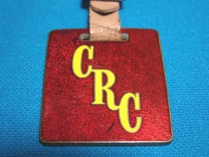 Crutcher Rolfs Cummings CRC Houston pocket watch fob vintage advertising enamel brass 1930s