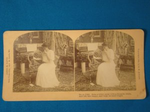 Girl love seat piano stereograph stereoview stereoscope card B.W. Kilburn antique 1909 J.M. Davis
