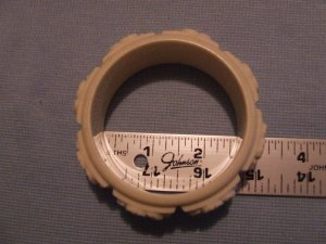 Bracelet. Molded white plastic. Nice detail. $4.90 shipping included.