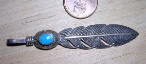 Silver feather pendant with turquoise accent