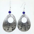 Product ID: 143     Etched Medium Aluminum Egg Shape Earrings  W Hole W Blue Glass Bead