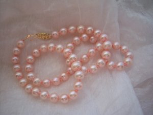 Genuine Freshwater Cultured Pink Pearl Strand Necklace with 14k Gold Clasp. MSRP: $249.00.