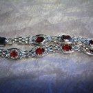 Sterling Silver Handmade Link Bracelet with Genuine handset Garnet gemstone.