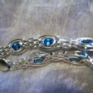 Sterling Silver handmade link bracelet with Blue Topaz gemstones.