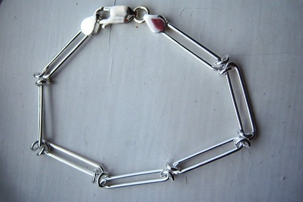 Sterling Silver Link Chain Bracelet with Lobster Clasp.