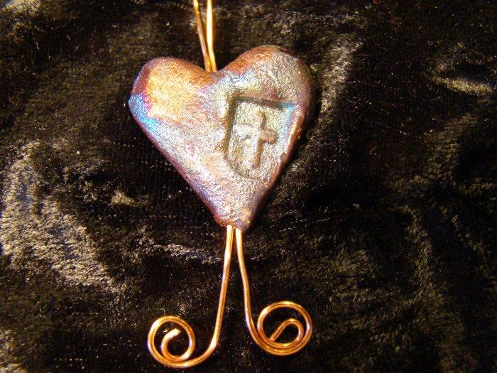 raku heart with cross pendant