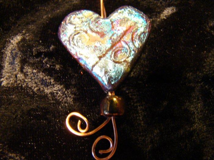 raku heart swirly design