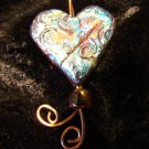 raku heart swirly design