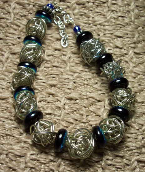 Silvertone Wire Globe Bracelet