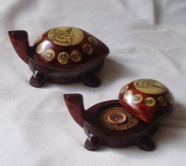 One Chinese wooden turtle with a compus inside SOLD!