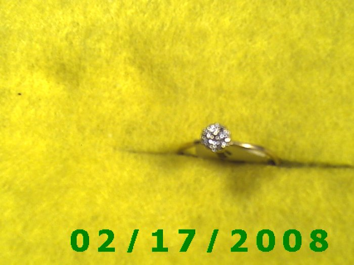 Ring Solid Gold, 10kt w/6 genuine diamonds    size 7 (F005)