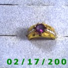 Gold platedRing size 7 China w/ruby and 8 clear stones