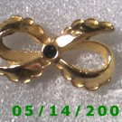 Gold Bow w/Emerald    B004