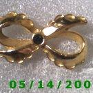 Gold Bow w/Emerald    B004