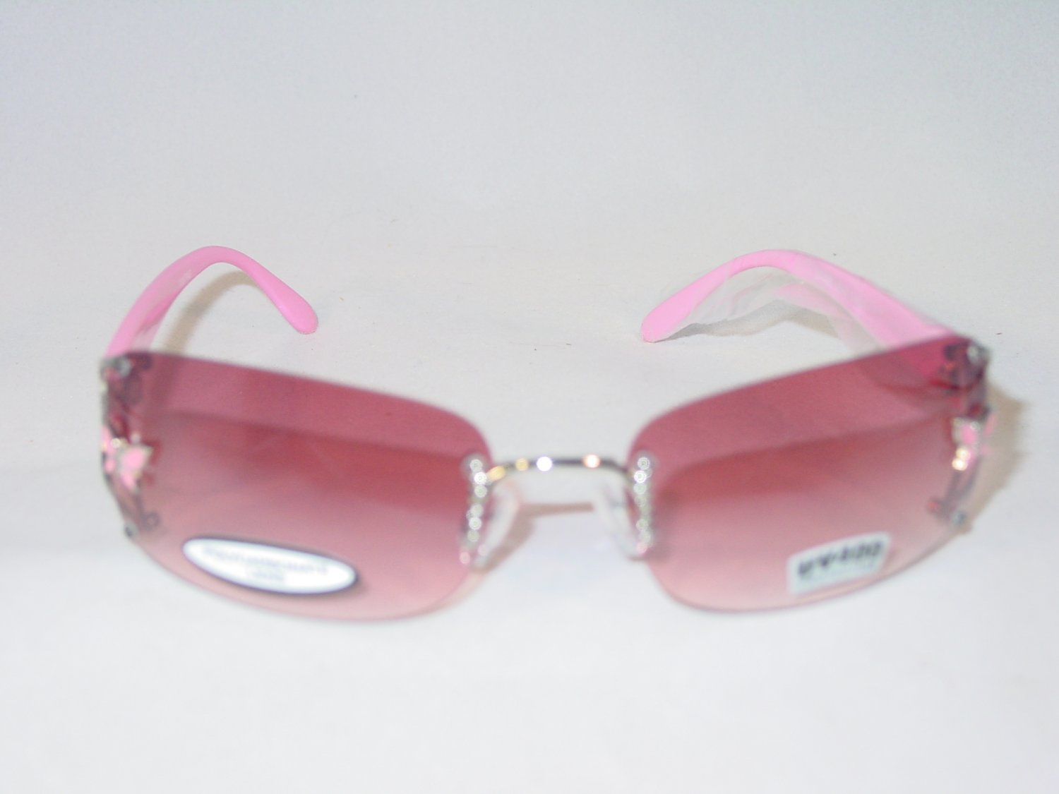Pink Butterfly Accent Pink Arms Pink Lens Rimless Sunglasses