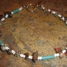 Leopardskin jasper bracelet with turqouise-colored accents