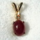 Ruby cabochon and round cz pendant in 14kt solid gold