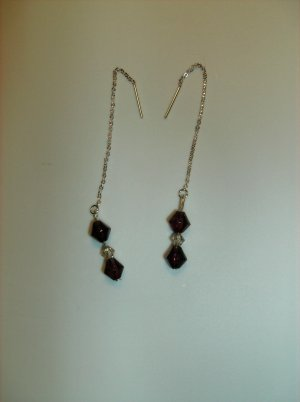 Drop earrings featuring garnet colored glass beads and cream pearls