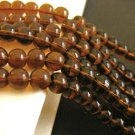 Brown 10mm Round Glass Beads Transparent