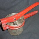Vintage antique kitchen tool potato ricer masher press
