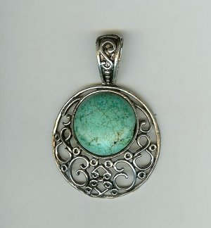 Round turquoise and pierced silver pendant