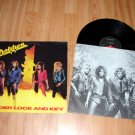 DOKKEN UNDER LOCK AND KEY VINYL LP RECORD