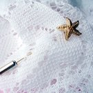 Sea Star stick pin by Sarah Coventry