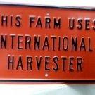 THIS FARM USES INTERNATIONAL HARVESTOR SIGN METAL ADV F
