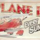 AIRPLANE RIDES TIN SIGN