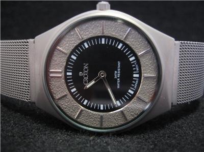 Croton Unisex/Ladies All Titanium - Weighs 1.1 oz Watch CR207886TNBK