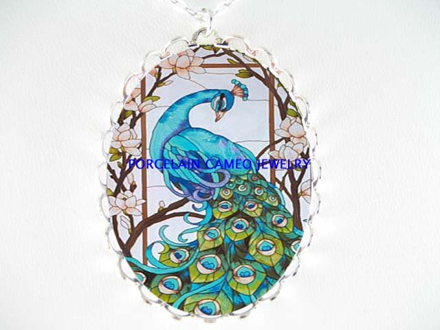 BLUE PEACOCK BIRD WITH DOGWOOD PORCELAIN CAMEO NECKLACE