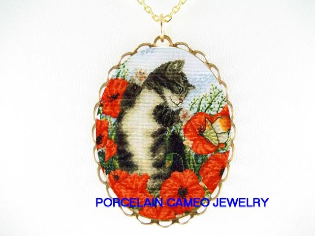 BLACK WHITE CAT CHASING BUTTERFLY POPPY CAMEO NECKLACE