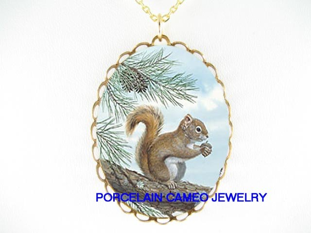 SQUIRREL HOLD NUT IN PINE TREE CAMEO PORCELAIN NECKLACE