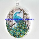 BLUE PEACOCK BIRD WITH DOGWOOD PORCELAIN CAMEO LOCKET