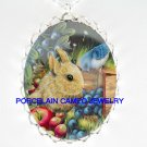 RABBIT BUNNY WITH BLUE BERRY APPLE BIRD CAMEO NECKLACE