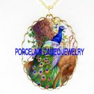 RARE BLUE PEACOCK IN THE TREE CAMEO PORCELAIN NECKLACE