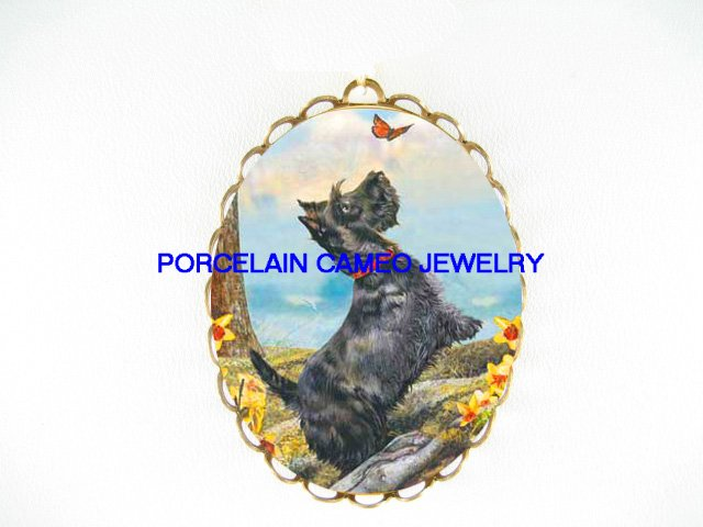 SCOTTISH TERRIER DOG CHASING BUTTERFLY DAFFODIL  CAMEO PORCELAIN PENDANT/PIN BROOCH