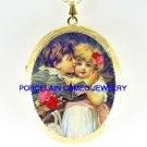 2 VICTORIAN CHILDREN BOY KISSING GIRL *  CAMEO PORCELAIN LOCKET NECKLACE