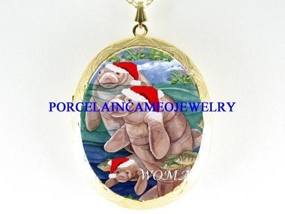 CHRISTMAS SANTA HAT MANATEE FAMILY CAMEO LOCKET NK