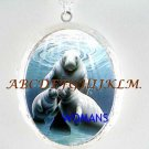 MANATEES MOM KISS BABY PORCELAIN CAMEO LOCKET NECKLACE
