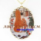 SQUIRREL EATING BERRY IN SNOW CAMEO PORCELAIN NECKLACE