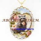 RACCOON HOLDING ROSE HEART PORCELAIN CAMEO NECKLACE