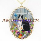 BLACK WHITE CAT PANSY BUTTERFLY PORCELAINCAMEO NECKLACE