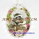 RACCOON MOM CUDDLE BABY ROSE PORCELAIN CAMEO NECKLACE