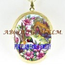 HUMMINGBIRD ENGLISH COTTAGE PORCELAIN CAMEO LOCKET NK