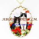 2 BLACK WHITE CAT POPPY DAISY PORCELAIN CAMEO NECKLACE