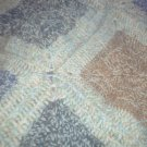 Brown, blue, green and tan throw