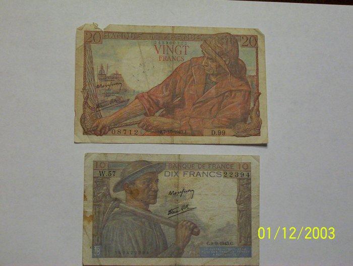 20 & 10 Franc bills.