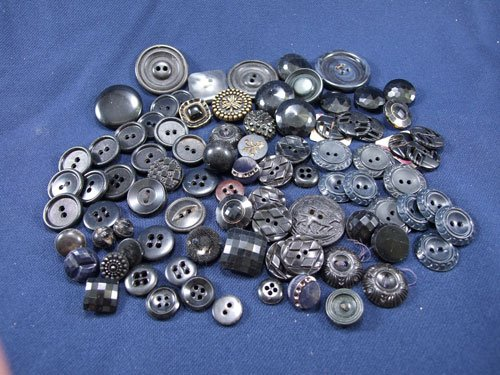 A Bag of Black Buttons Various Size and Shapes