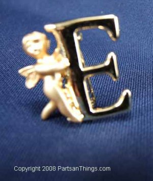 Gold Letter E Pin being held by Angle